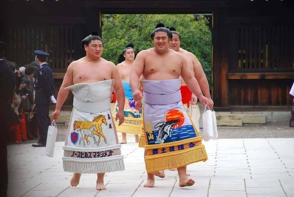 sumo wrestlers preparing to step into the ring
