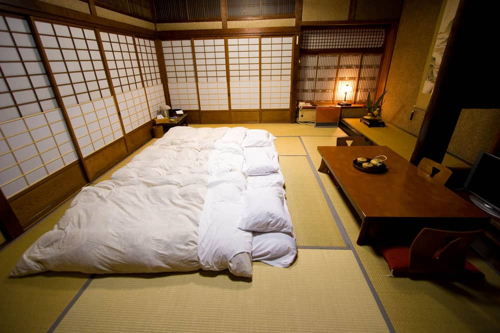 ryokan with tatami mat floor and low wooden table